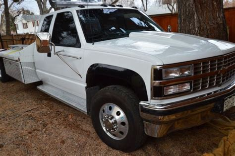 1992 chevy 4 wheel drive flat bed car hauler with 92k for