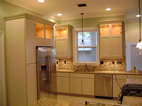 cream kitchen cabinets with white trim white molding trim but off white cabinets does this