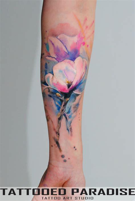 watercolor flowers tattoo on forearm by aleksandra katsan