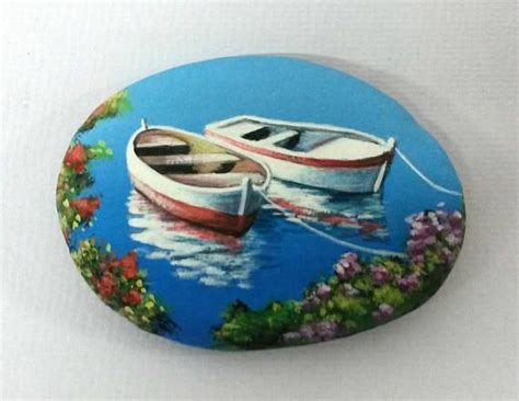 pebble art fishing boat painted stone landscape with two fishing boats is painted