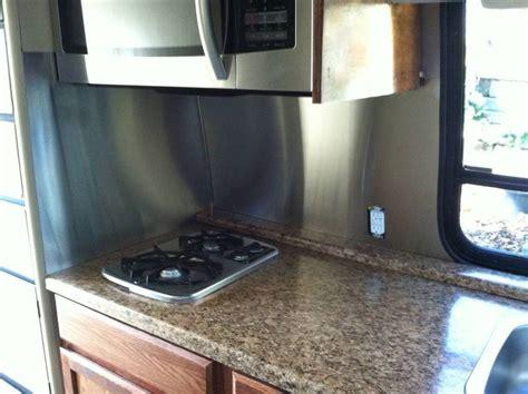 kitchen backsplash done stainless steel