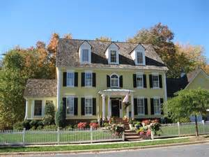 yellow and white houses house shutters exterior colors yellow body white trim black shutters homes i pinterest