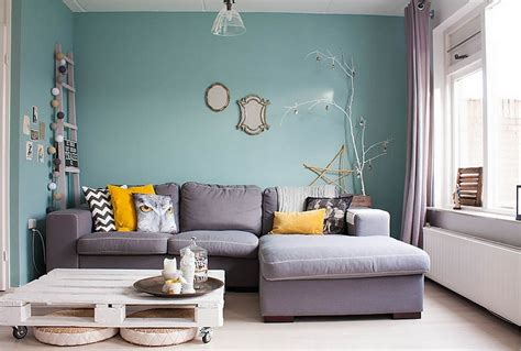 lovely living room interior desig with blue wall paint color and l shaped grey fabric sofa idea