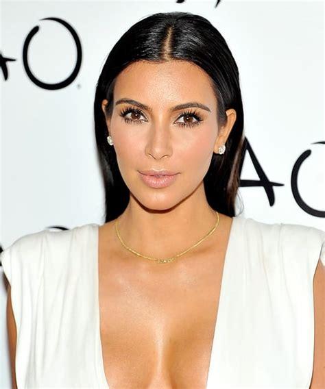 kim kardashians low sleek ponytail with center part celebrity sleek center part kim kardashian s best hairstyles ever