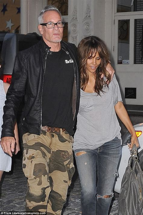 Halle Berry Has A New Dating Strategy by Halle Berry Cuddles Up To Photographer Cliff Watts While