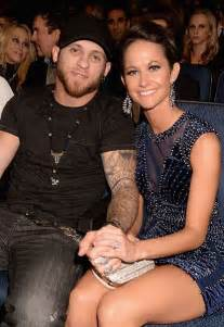 Brantley gilbert shows off his fiancee amber cochran at the american