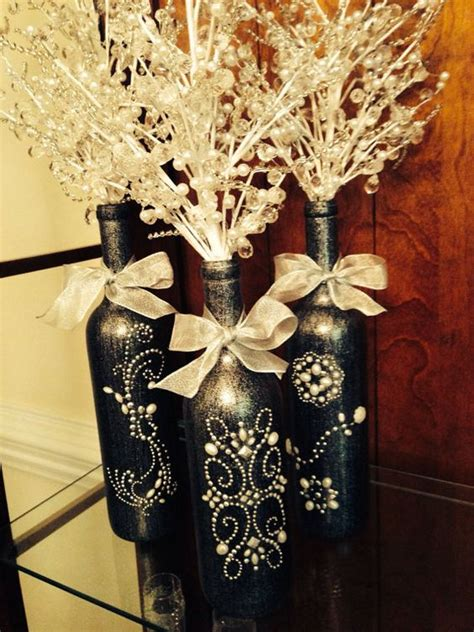 3 decorated wine bottle centerpiece with crystal insert