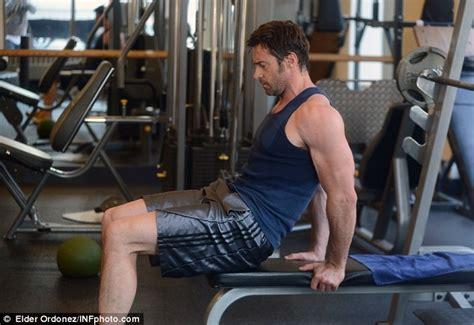 hugh jackman flexes his mean biceps and rock hard abs