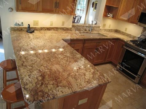 beige kitchen cabinets with typhoon bordeaux granite typhoon bordeaux granite countertops with beige tile