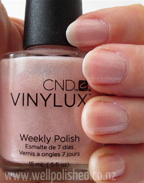 cnd vinylux topcoat and polish in grapefruit sparkle grapefruit sparkle vinylux well polished