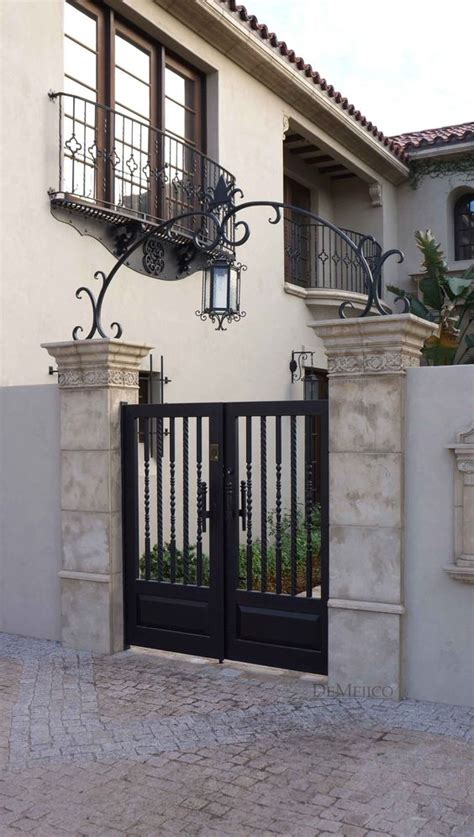 a classic and custom wrought iron entry gate complimented