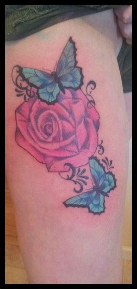 butterfly on a rose tattoo pink blue butterfly on biceps tattooshunt