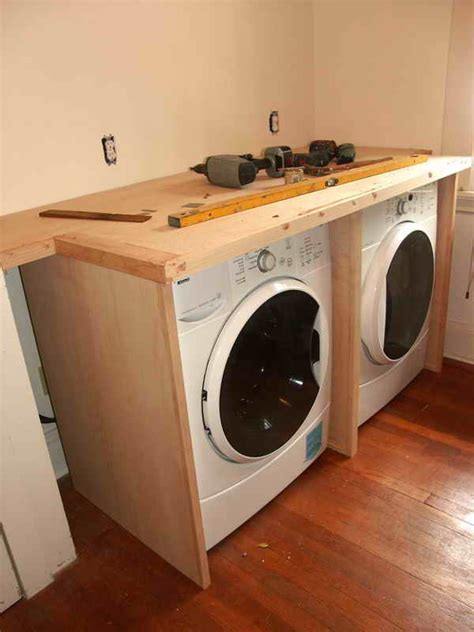 cabinets above washer dryer hide washer dryer in hall top loading recherche google