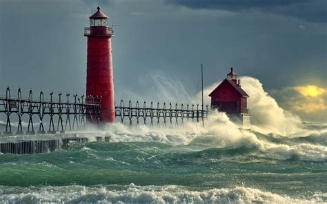 red lighthouse  withstand  onslaught   waves