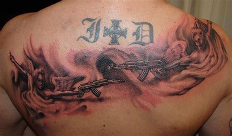 tattoo angel with guns gun tattoo images designs