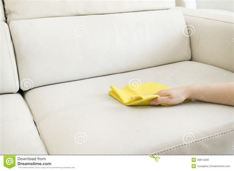 how to clean a couch by hand cleaning a beige sofa stock photo image of hand clean