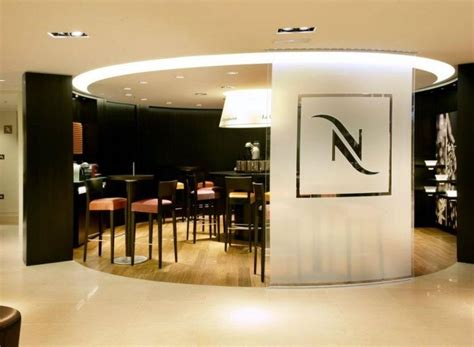 designboom nespresso andreu world furnishes nespresso boutiques around the