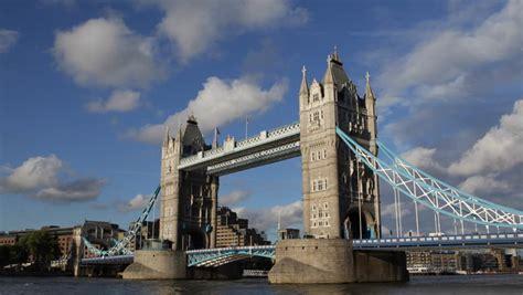 thames river boat london bridge tour boat ship passing near tower bridge london uk thames