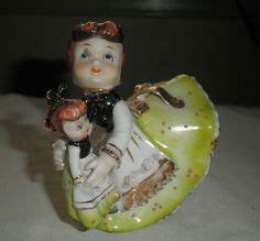 vintage 1956 geo z lefton christmas girl bell holding a