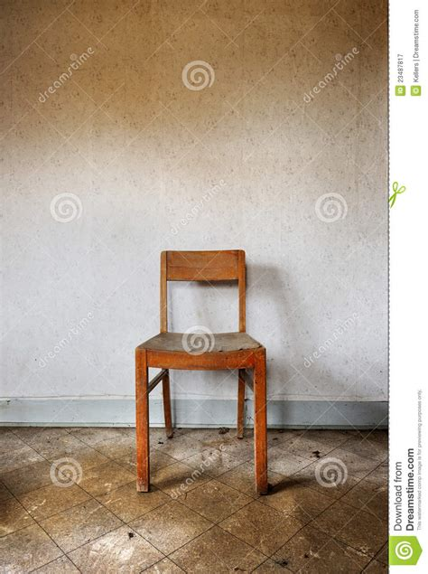 The Chair Is Against The Wall by Chair Against Wall Royalty Free Stock Photography Image