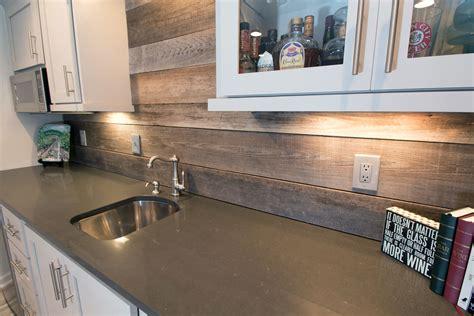 reclaimed wood backsplash closeup of back bar with new granite countertops
