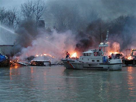 fire boat fighting fire five winter disasters don t let these happen to your boat