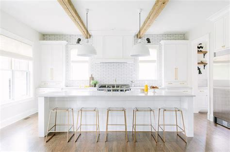white kitchen island with stools white shiplap kitchen island with brass and lucite counter