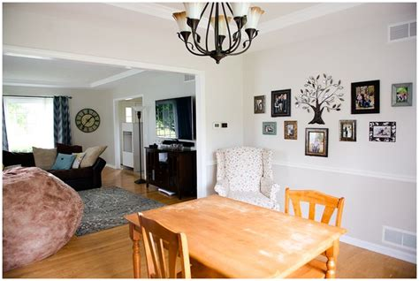 sherwin williams downy agreeable gray by sherwin williams paint color above the chair rail in the dining room is