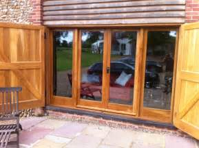 Sliding Wood Patio Doors Brown Teak Wood Frame Sliding Patio Glass Door Combination With Large Pine Wood Pallet