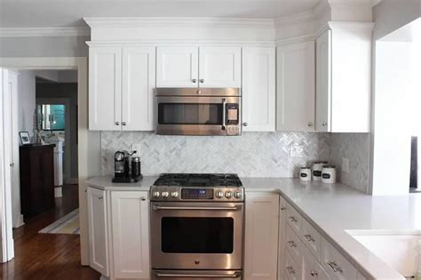 gray distressed kitchen cabinets with marble herringbone caesarstone london grey countertops white painted
