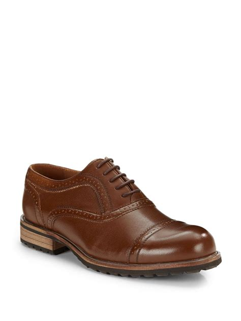 steve madden dress shoes lyst steve madden perforated brogue dress shoes in brown