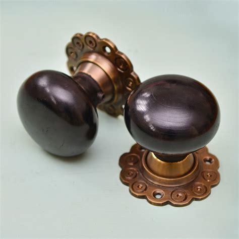 Aged Brass Door Knobs by Solid Bun Door Knobs Pair Aged Brass Collar