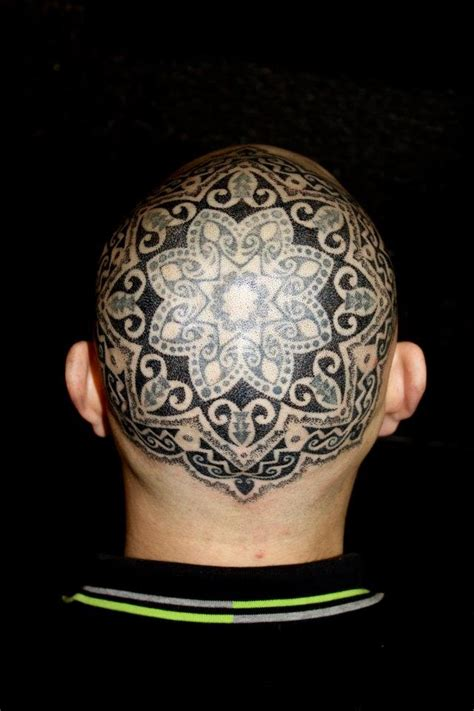 bald head tattoo dotwork mandala tattoos