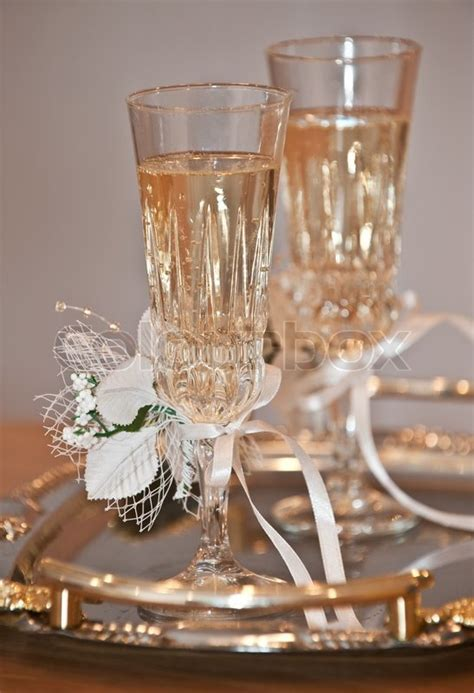 Wedding glasses. Glasses with a champagne decorated