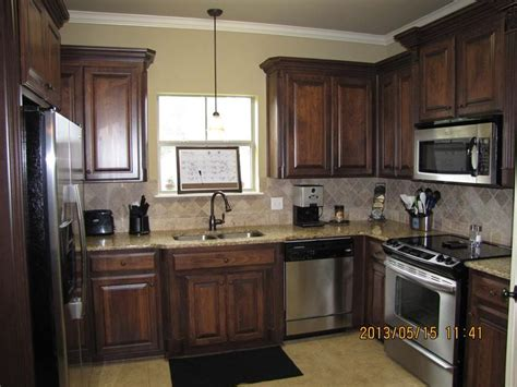 painting vs staining kitchen cabinets kitchen interesting staining kitchen cabinets diy
