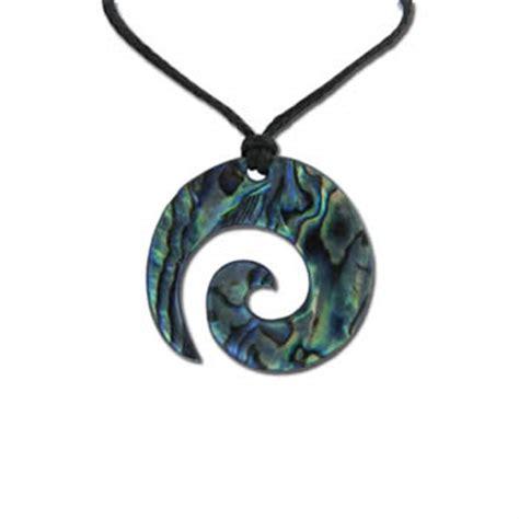 traditional koru pendant in new zealand paua shell