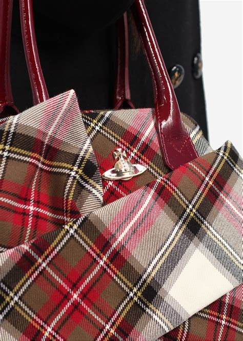 Be Tartan And Plaid Pretty In This Vivienne Westwood Dress by Vivienne Westwood New Exhibition Winter Tartan Bag Aw13