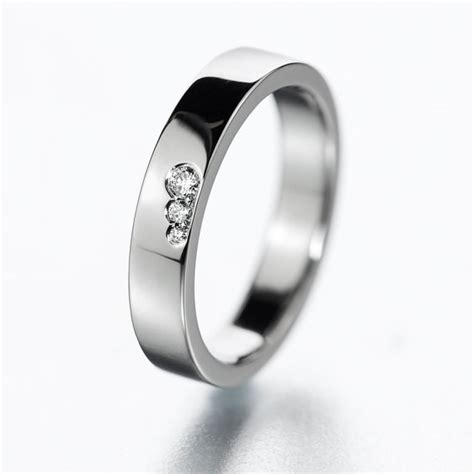 wedding band or engagement ring with diamonds simple
