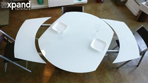 Baobab round white glass extendable kitchen table on wood