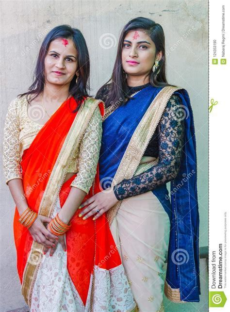 Beautiful Nepali Teen Girls In Colorful Sarees Editorial