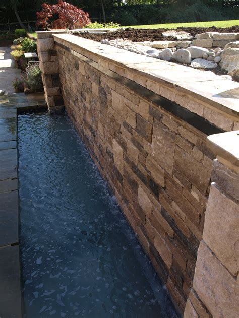wet wall water feature with natural effect stream and pool landscape garden designers reading