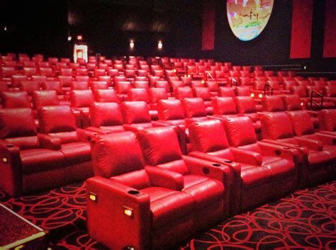 recliner movie theater amc red recliners two women sitting on the plushy red