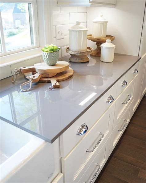 Grey Kitchen Cabinets With White Countertops by There S Just Something About A Bright Kitchen With White