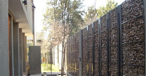 Pagar Besi Ram jasa konstruksi bangunan pagar batu bronjong alternatif