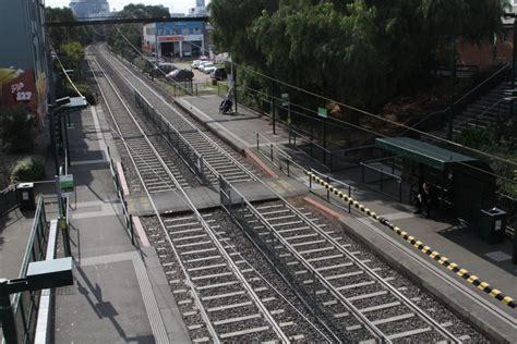light rail stops pedestrian level crossing splits the platforms in half at