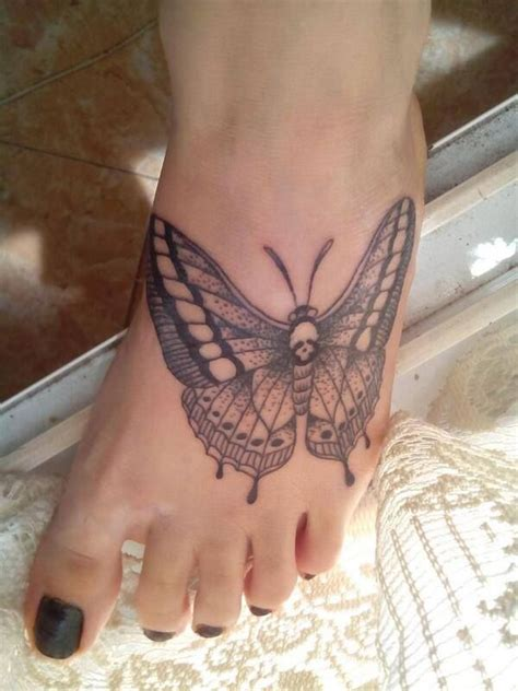 my butterfly tattoo foot black linework dotwork