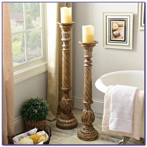 Glass Floor Candle Holders by Glass Floor Pillar Candle Holders Home Decorating Ideas