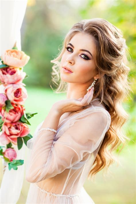 hd picture young beautiful woman stroking earrings