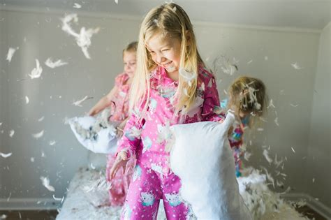 Feather Pillow Fight by Pillow Fight Photo Shoot Eastern Nc Wedding Photographers
