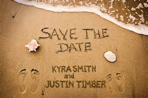 wedding save the dates footprints in the sand